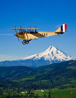 Western Antique Aeroplane and Automobile Museum owns this Curtiss Jenny, seen here flying by Mt. Hood.